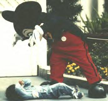 Mickey Mouse costumed character traumatizing a child